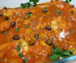 Filetti di pangasio con peperoni e olive taggiasche