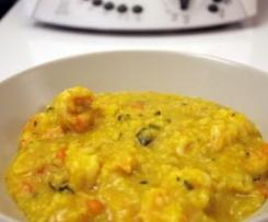 Paella con gamberi e verdure