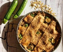 Crostata salata di brisè all'avena e vino ripiena di zucchine e caprino