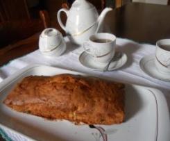 Plum-cake profumato all'arancia con uvetta e scorzette candite