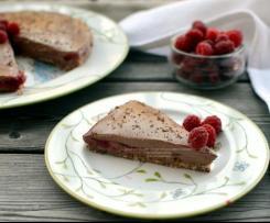 Cheesecake con mousse al cioccolato e zenzero con lamponi