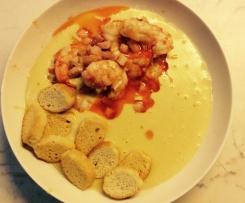 Code di gamberi su zuppa di ceci