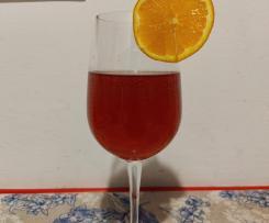 Cocktail alla melagrana, bitter e tè speziato