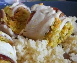 Rotoli di pollo e speck al curry con cous cous