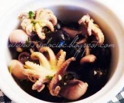 Polipetti in bianco con olive, limone e capperi