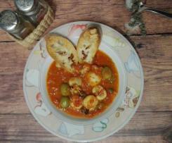 Seppioline in guazzetto con capperi, olive e pane tostato